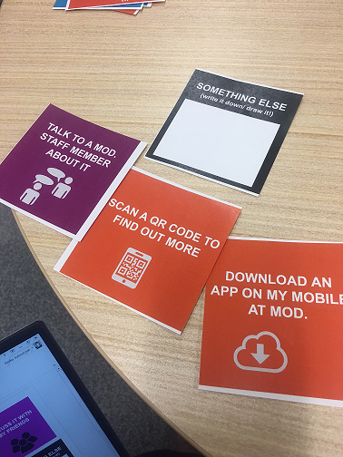 "Images of 4 different colour cards with icons and descriptions on them 'Talk to a MOD. staff member', ""Download and app on my mobile phone' etc"