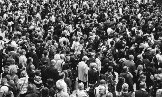 Image of a crowd of people in black and white